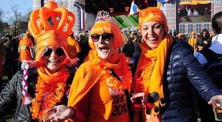 People dressed up in orange at the OranjeFeest