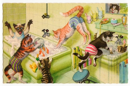 Painting of cats frolicking in the bathroom