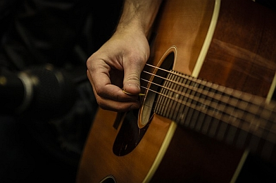 Pic of guitar with hand