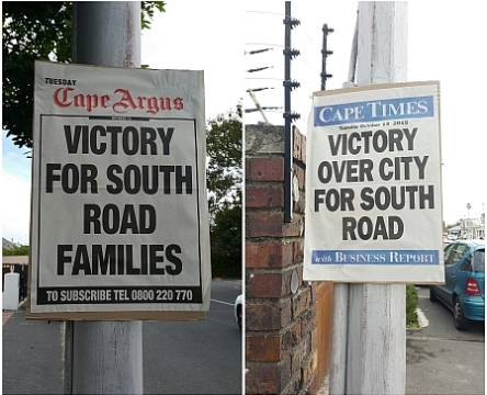 Newspaper posters proclaiming South Road Families victory